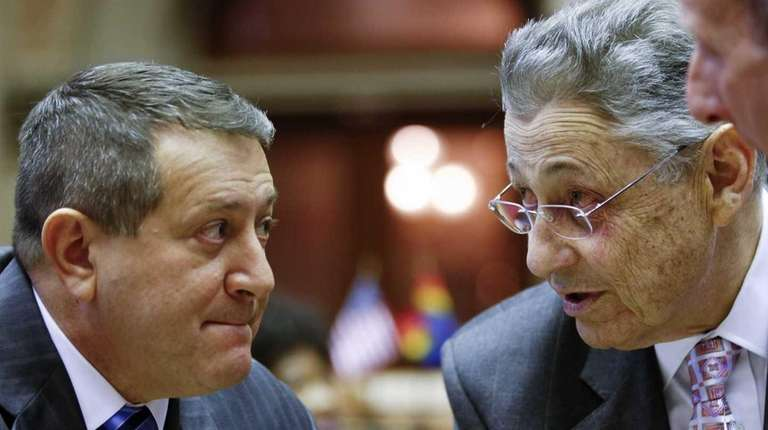 Former Assembly Speaker Sheldon Silver, right, talks with