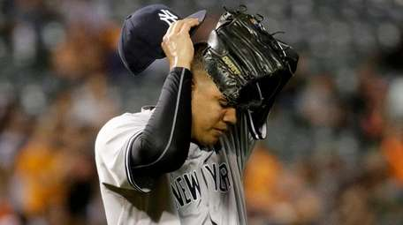 New York Yankees relief pitcher Dellin Betances wipes