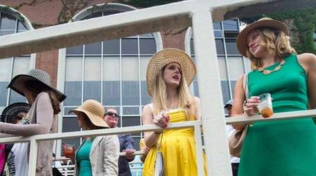 Horse-racing fans gather for the running of the