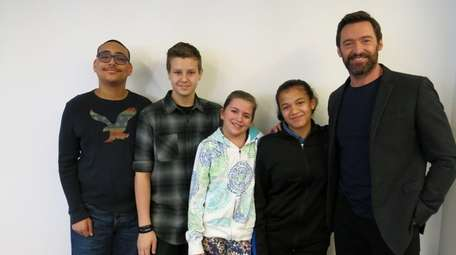 Actor Hugh Jackman with Kidsday reporters from left,