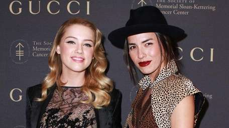 Amber Heard and Tasya van Ree attend an