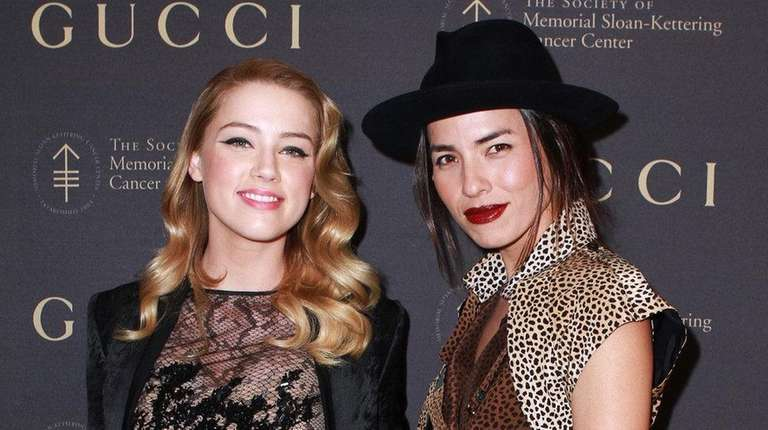 Amber Heard and Tasya van Ree attend an