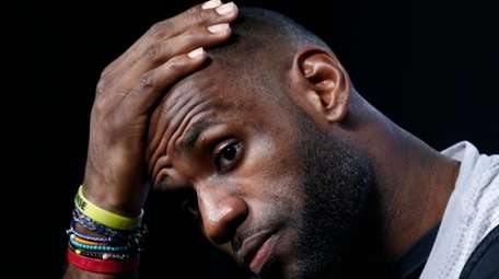 Cleveland Cavaliers player LeBron James speaks to the