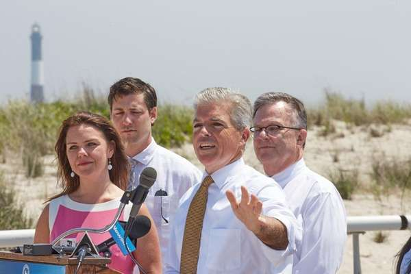 Suffolk County Executive Steve Bellone, center, joins state