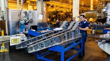 Workers on the factory floor at Magellan Aerospace