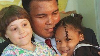Danielle D'Ecclesiis, 6, Baldwin, left, and Ashley Adams,