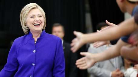 Hillary Clinton greets supporters during a rally at