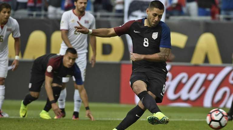 USA's Clint Dempsey shoots to score a penalty
