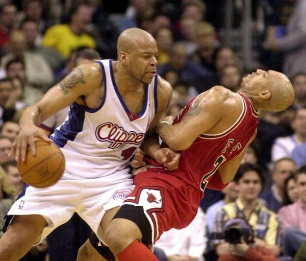 The Chicago Bulls' Marcus Fizer, right, is knocked