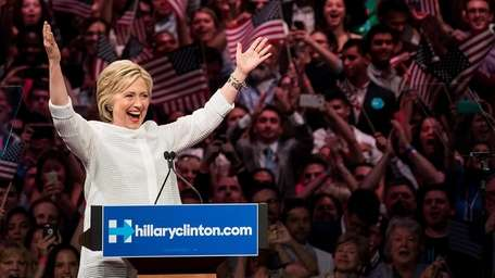 Democratic presidential candidate Hillary Clinton gestures to the