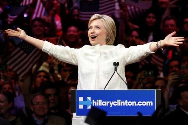 Democratic presidential candidate Hillary Clinton gestures to supporters