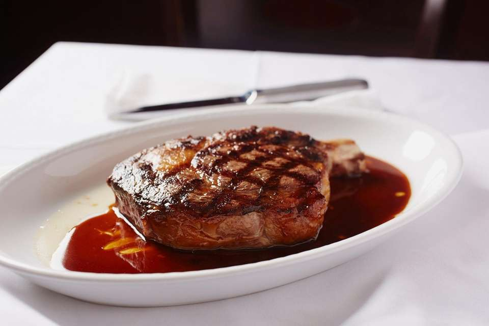 Bone-in-ribeye is served at Prime 23, Freeport Nautical