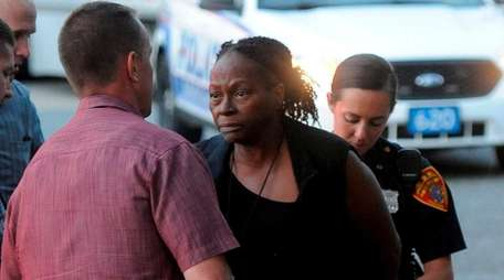 Suffolk County police take Ada Robinson, 60, into
