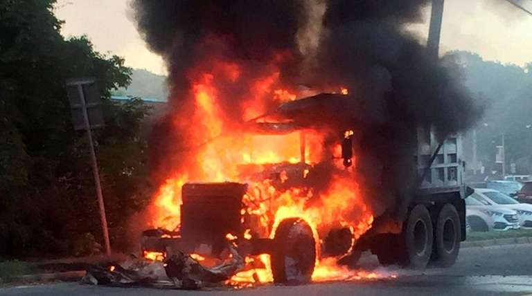 Flames engulf a 10-wheel dump truck on Park