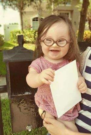 Emersyn Faith, 15 months, helps her mom mail
