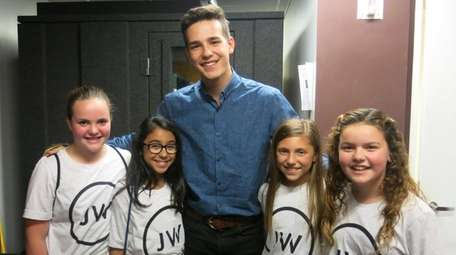Singer Jacob Whitesides with Kidsday reporters, from left,