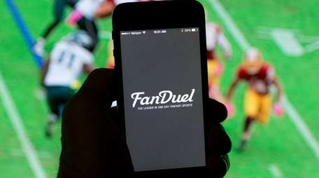 In this photo illustration, FanDuel one of the