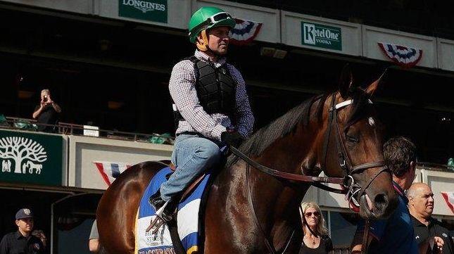 Jockey Kent Desormeaux rides Exaggerator onto the track