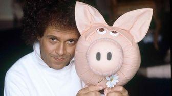Exercise guru Richard Simmons poses with a stuffed