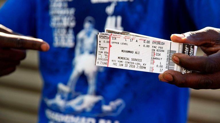 Montez Jones, of Louisville, shows off his tickets