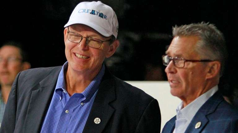 Winstar Farm racing manager Elliott Walden, left, shares