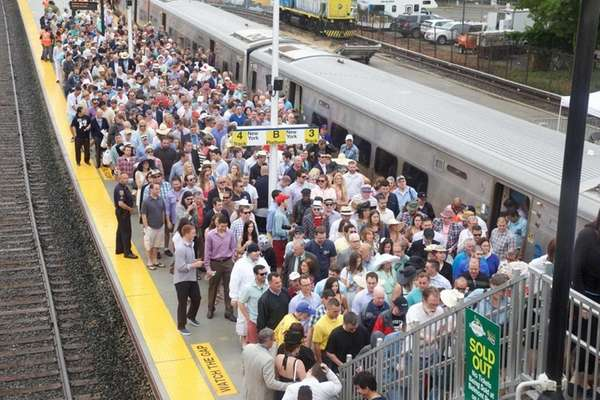 Crowds arrive by Long Island Rail Road for