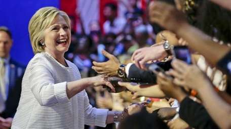 Democratic presidential candidate Hillary Clinton greets supporters as