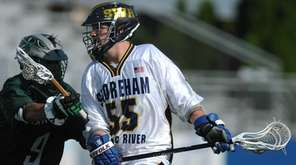Kevin Cutinela #55 of Shoreham-Wading River, right, gets