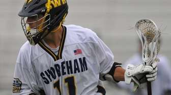 Jon Constant of Shoreham-Wading River carries behind the