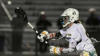 Andrew Lockhart of Ward Melville scores a goal