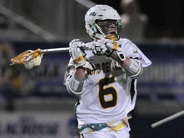Eddie Munoz of Ward Melville moves the ball