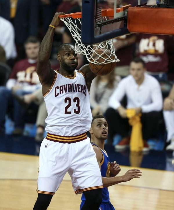 Cleveland Cavaliers forward LeBron James (23) dunks as