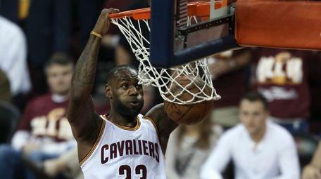 Cleveland Cavaliers forward LeBron James (23) dunks as