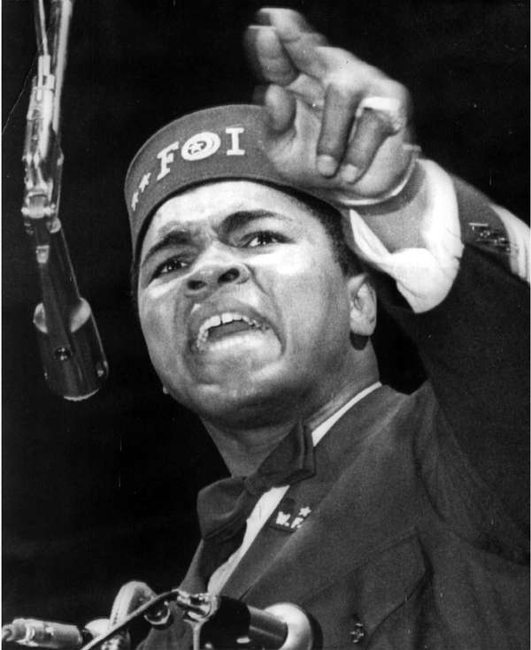Muhammad Ali addresses a gathering at a Black