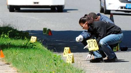 Suffolk police investigators study the location in Brentwood