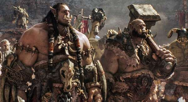 Durotan (voiced by Toby Kebbell), left, and Orgrim