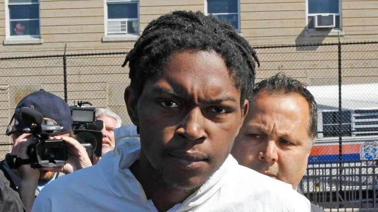 Khalif House, 24, leaves Nassau Police headquarters on