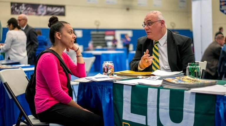 Dowling College student Stephanie Rubio, of Brentwood, left,