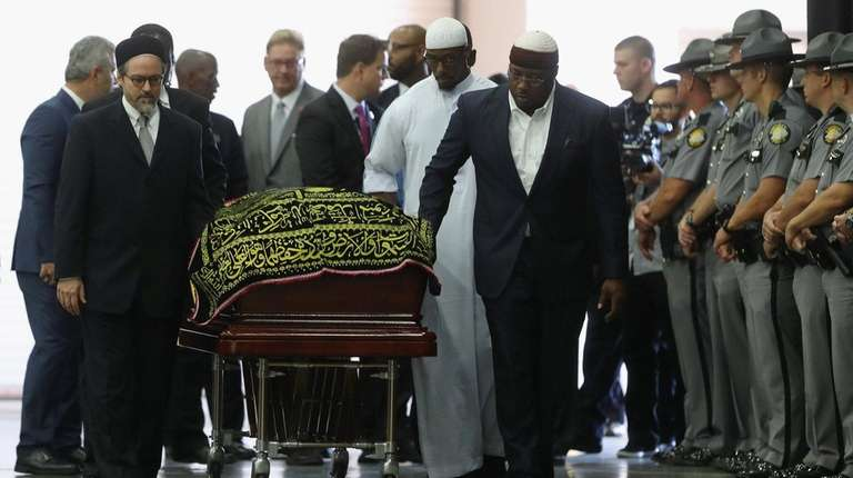 The casket with the body of Muhammad Ali