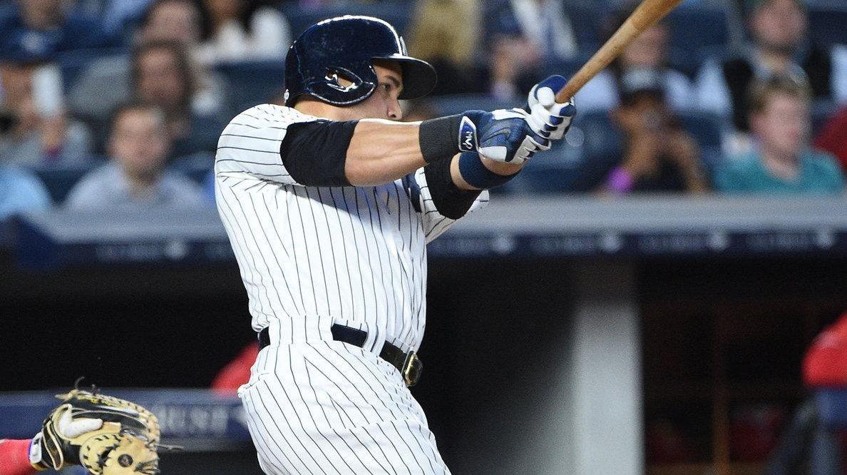 New York Yankees rightfielder Carlos Beltran hits a