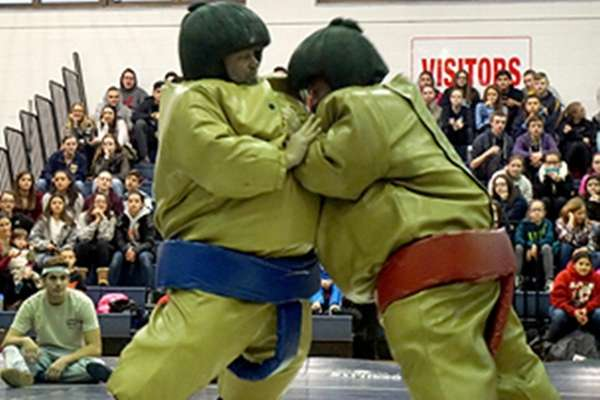 Principals and teachers participated in sumo wrestling.