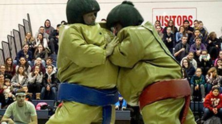 Principals and teachers participated in sumo wrestling.