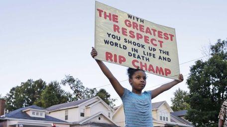 Akera Price-King, 9,honors Muhammad Ali on the street