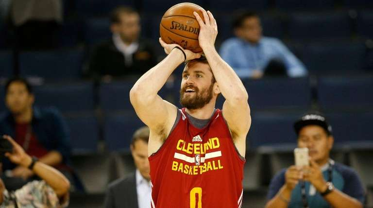 Kevin Love of the Cleveland Cavaliers shoots during
