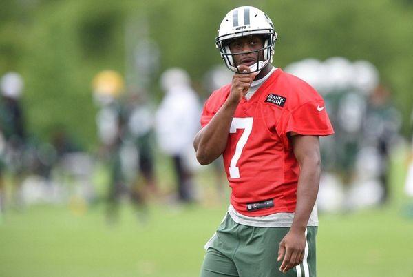 New York Jets quarterback Geno Smith looks on