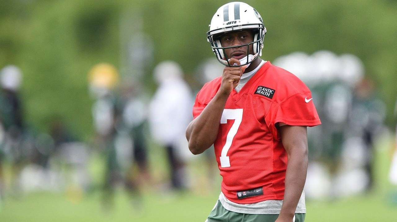 New York Jets quarterback Geno Smith looks on