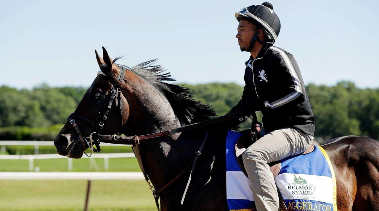 Exaggerator trains with exercise rider Peedy Landry prior