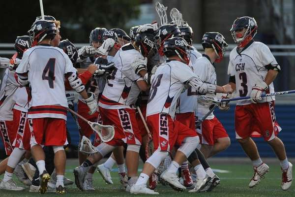 Cold Spring Harbor players celebrate their 12-10 win