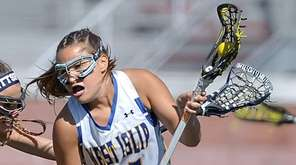 West Islip's Vanessa Costantino, right, is defended by