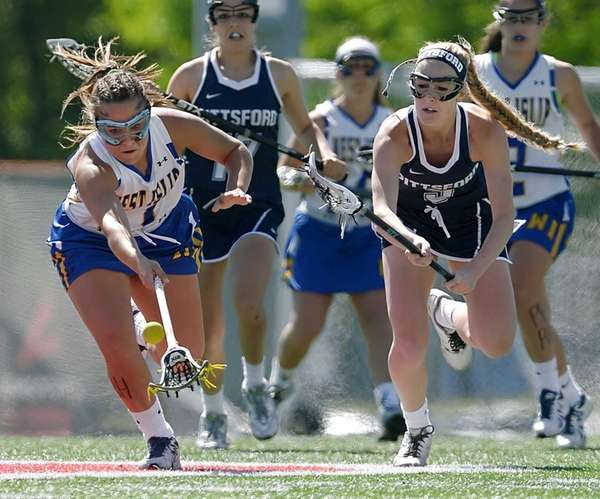 West Islip's Vanessa Costantino, left, reaches for the
